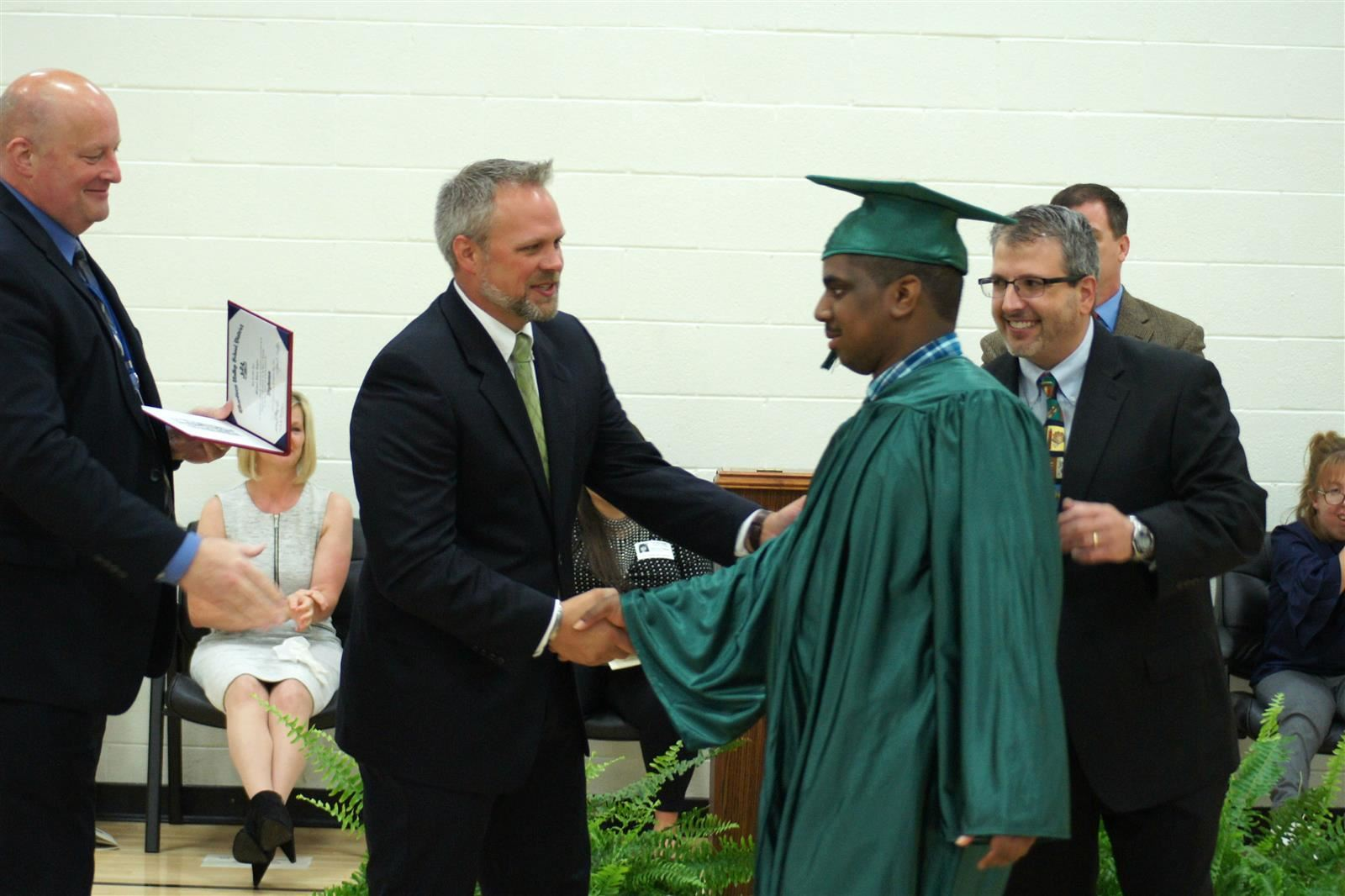 A student is congratulated during graduation.
