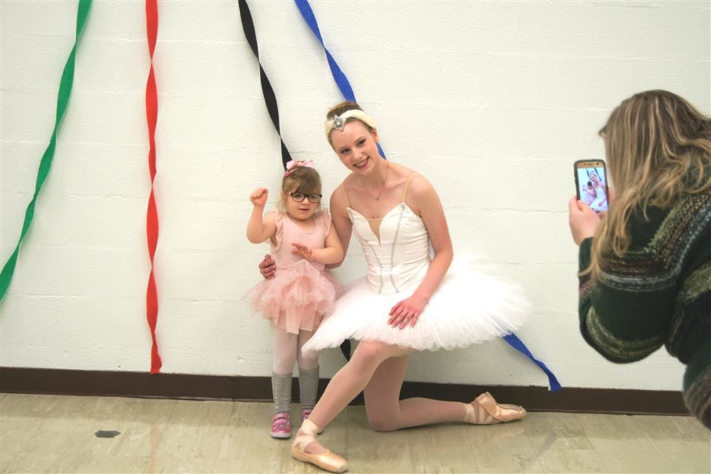 A student poses with a ballerina during a Pathfinder school event.