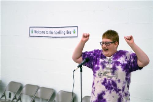A student celebrates after winning the spelling bee.