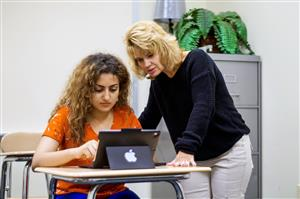 A BVISP student and her teacher work together.