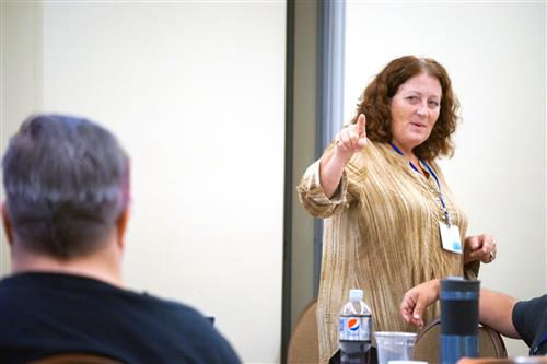 Presenter Eileen Cirelli points to an audience member at a recent conference.