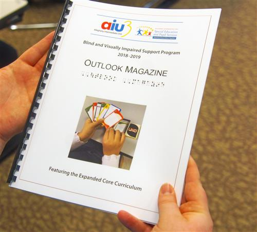 A finished copy of Outlook Magazine.