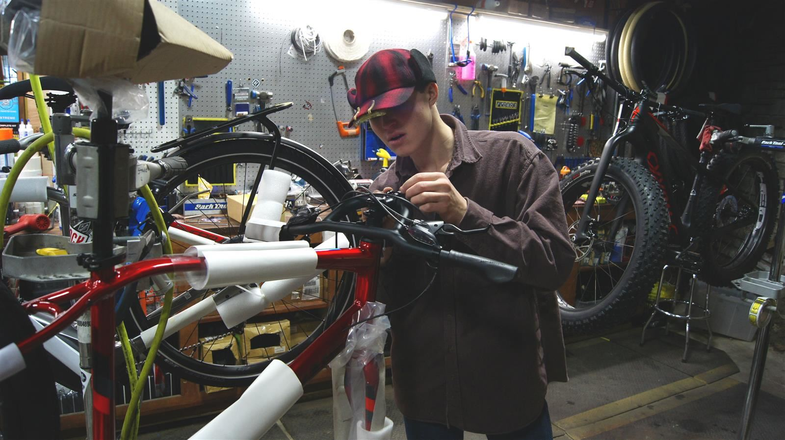 Student repairing bicycle